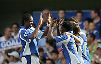 Photo: Lee Earle.<br /> Portsmouth v Wigan Athletic. The Barclays Premiership. 09/09/2006. Portsmouth's Kanu (L) congratulates Benjani after he scored the opening goal.