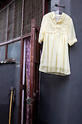 A frilly yellow woman's shirt hanging out to dry in Beijing.