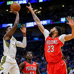 Mar 21, 2018; New Orleans, LA, USA; Indiana Pacers guard Victor Oladipo (4) shoots over New Orleans Pelicans forward Anthony Davis (23) during the first quarter at the Smoothie King Center. Mandatory Credit: Derick E. Hingle-USA TODAY Sports