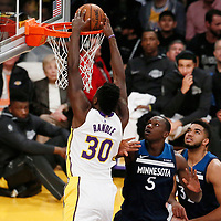 25 December 2017: Los Angeles Lakers forward Julius Randle (30) dunks the ball past Minnesota Timberwolves center Gorgui Dieng (5) and Minnesota Timberwolves center Karl-Anthony Towns (32) during the Minnesota Timberwolves 121-104 victory over the LA Lakers, at the Staples Center, Los Angeles, California, USA.