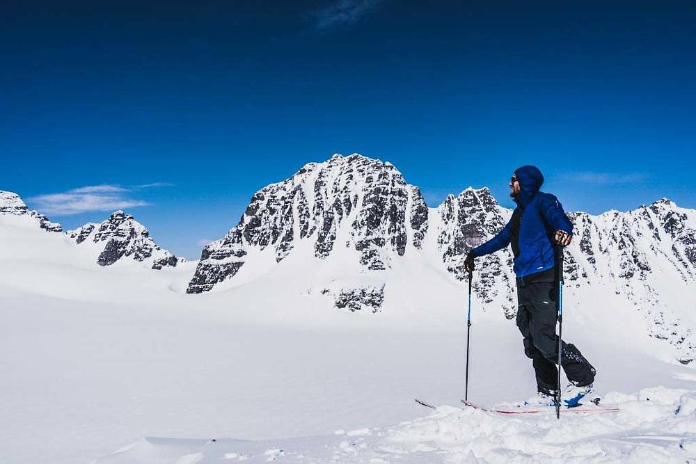 Simon Thomson soaks it up from the summit of Loft Peak, Howson Range, British Columbia.