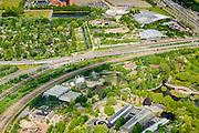 Nederland, Zuid-Holland, Rotterdam, 10-06-2015; Diergaarde Blijdorp in de Blijdorpse Polder, omgeven diverse spoorlijnen en autowegen. Biotopia met Rivierahal in de voorgrond, Oceanium in de achtergrond.<br /> Blijdorp Zoo in the North of Rotterdam.<br /> luchtfoto (toeslag op standard tarieven);<br /> aerial photo (additional fee required);<br /> copyright foto/photo Siebe Swart