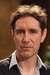"© Licensed to London News Pictures. 07/04/2014. London, England. Pictured: Actor Paul McGann as Vershinin. The play ""Three Sisters"" by Anton Chekhov, in a new version by Anya Reiss, opens at the Southwark Playhouse, London, with Paul McGann as Vershinin, Olivia Hallinan as Olga, Emily Taaffe as Masha and Holliday Grainger as Irina. Directed by Russel Bolam. Photo credit: Bettina Strenske/LNP"