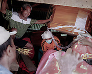 Family members take out coffins out of the tomb.<br /> <br /> Ma'nene is a tradition that takes place in August after harvest where the bodies of the dead loved ones are exhumed to be cleaned, groomed and dressed. For most, it's a bittersweet moment, a chance to reunite and physically see and touch and reconnect with loved ones who had passed on.
