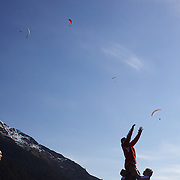 The Georgian team training at Recreation Park, Queenstown, in preparation for the IRB Rugby World Cup as paragliders descending from skyline lookout, prepare to land in a nearby field. Queenstown, New Zealand, 7th September 2011. Photo Tim Clayton....