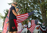 Parade marchers with the American Legion await the start of the Gilmanton 4th of July parade Tuesday morning.  (Karen Bobotas/for the Laconia Daily Sun)