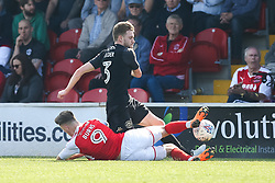 Wes Burns of Fleetwood Town tackles Callum Elder of Wigan Athletic - Mandatory by-line: Robbie Stephenson/JMP - 21/04/2018 - FOOTBALL - Highbury Stadium - Fleetwood, England - Fleetwood Town v Wigan Athletic - Sky Bet League One