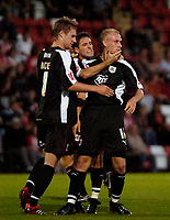 Photo: Ed Godden.<br /> Cheltenham Town v Bristol City. Carling Cup. 22/08/2006.<br /> David Cotterill (R) is congratulated by his Bristol team mates after scoring.