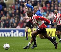 Picture: Henry Browne.<br />Date: 20/03/2004.<br />Reading v Sunderland Nationwide First Division.<br /><br />Darren Byfield of Sunderland tries to escape from Reading's James Harper.