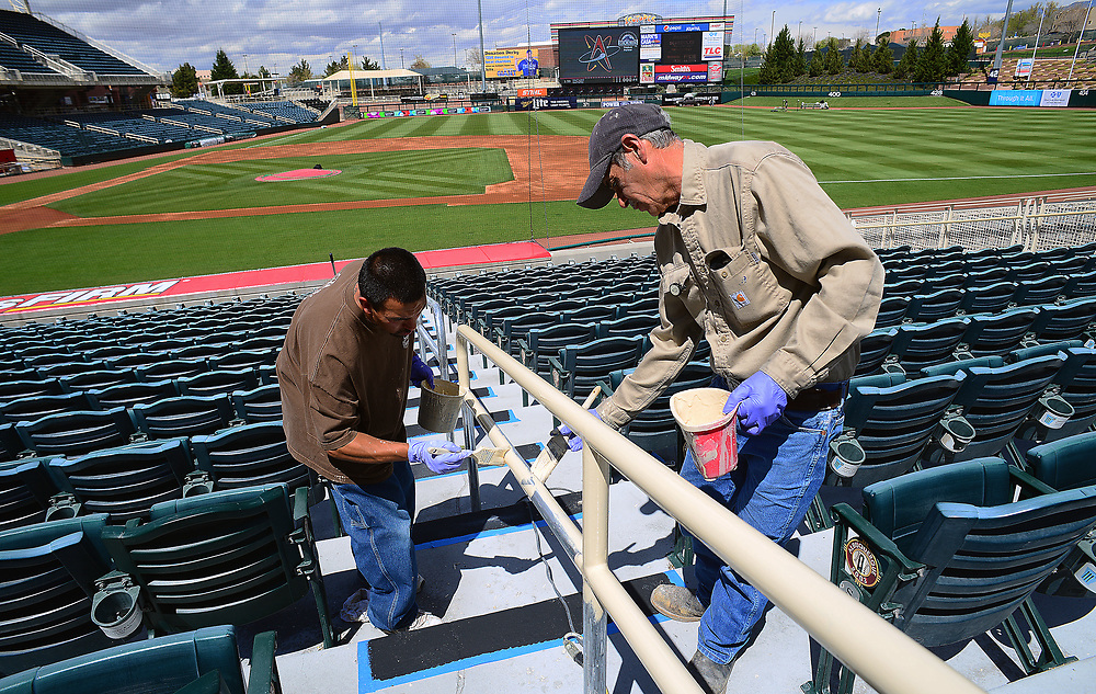 apl040317a/SPORTS/pierre-louis/JOURNAL 040317<br /> Ambrose Gonzales,, left and Roger Medina paint a railing at the Albuquerque Isotopes Stadium while getting ready for Thursday Opening Day .Photographed on Monday April 3, 2017. .Adolphe Pierre-Louis/JOURNAL