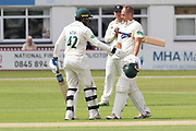 100 - Neil Dexter is congratulated by Hassan Azad on reacing 100 during the Specsavers County Champ Div 2 match between Leicestershire County Cricket Club and Gloucestershire County Cricket Club at the Fischer County Ground, Grace Road, Leicester, United Kingdom on 17 June 2019.