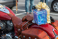 A package rests on the rear of Matt Johnson's motorcycle  of Langhorne, dressed as Santa while riding his Indian Motorcycle along with other members of the Delaware Valley Iron Indian Riders Association who held their annual Ride Of the Santas and dropped off toys to children at  Saturday, December 21, 2019 at St Francis-St Vincent Home For Children in Bensalem, Pennsylvania. (Photo by William Thomas Cain / CAIN IMAGES)