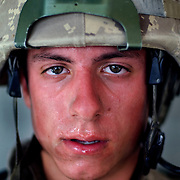 Aug 13, 2009 - Kandahar Province, Afghanistan - Canadian Soldier Cpl Adam Boily age 21, seen after a Patrol in extreme heat in the volatile Panjway District located west of Kandahar City, Afghanistan. This is Canada's first combat deployment since the Korean War. Canada has suffered one of the highest casualty rates of the war in Afghanistan and has announced that it will be pulling out all Canadian combat troops by 2011. <br /> The Canadian Press Images/Louie Palu<br /> CANADIAN SALES AND USE ONLY. NO INTERNATIONAL SALES OR USE.