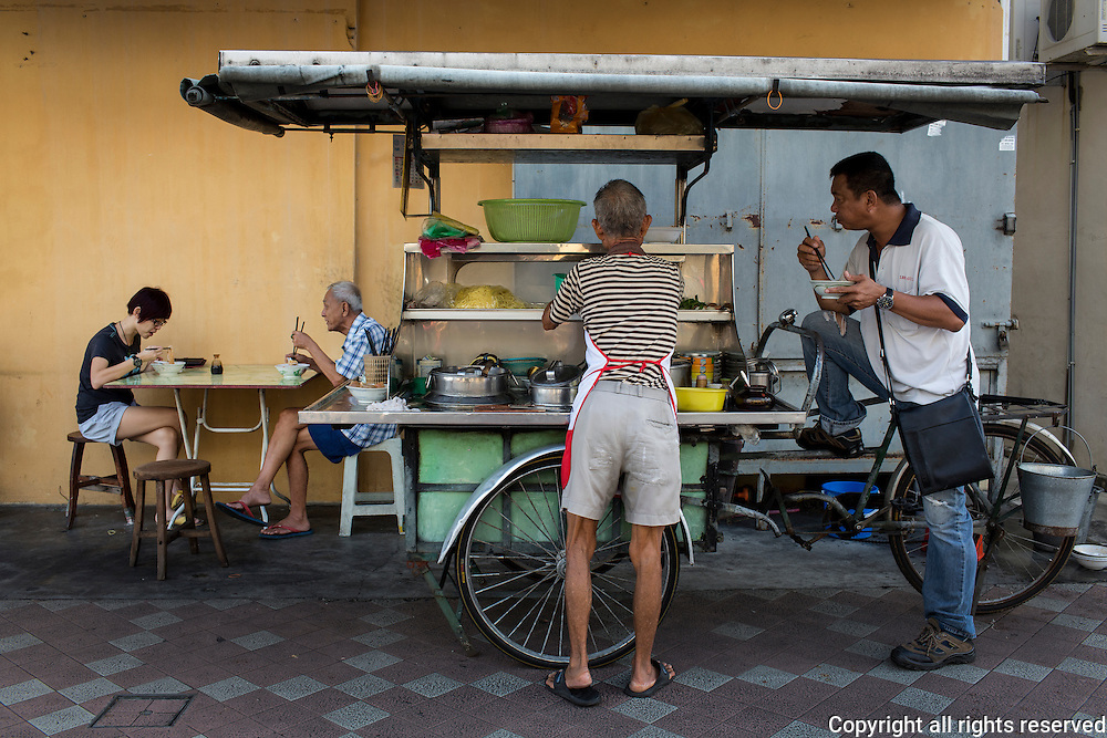 a mobile vendor of hokkien mee near Campbell Street Market, George Town, Penang, Malaysia