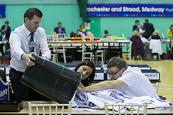 © Licensed to London News Pictures . 20/11/2014 . Kent , UK . A ballot box is tipped out in the counting hall , at Medway Park in Gillingham . The count for the Rochester and Strood by-election , following the defection of sitting MP Mark Reckless from Conservative to UKIP . Photo credit : Joel Goodman/LNP