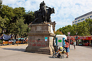 "Statue with graffiti, at protest camp at Placa de Catalunya, Barcelona, Spain. Graffiti reads ""o los fusilles, o las cadenas"" - guns or chains. The square has been relatively quiet since police attacked and beat protestors on May 27 2011."
