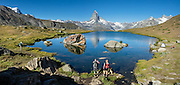 Within 15 minutes walk from Stellisee lake, relax at Bergrestaurant Fluhalp at the heart of the Sunnegga-Blauherd-Rothorn hiking & ski region, in Zermatt, the Pennine/Valais Alps, Switzerland, Europe. Experience Stellisee best at sunrise with great reflections of the Matterhorn, after overnight stay at Fluhalp (half board meals, coin showers, private rooms & dormitory), 40 minutes walk from Blauherd lift. The best parts of the Five Lakes Trail / 5-Seenweg loop are the old wood buildings in upper Findeln, and the reflecting lakes of Grindjisee and Stellisee. This image was stitched from multiple overlapping photos.