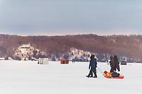 Ice fishing on Crystal Lake in Beaulah, Michigan.