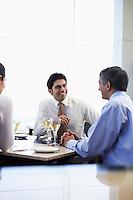 Business associates smiling having business meeting