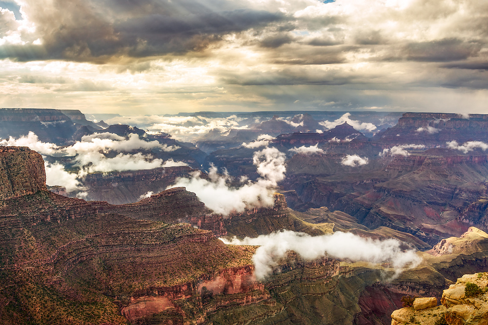 The fog begins to lift after a rainy day during monsoon season in the Grand Canyon.