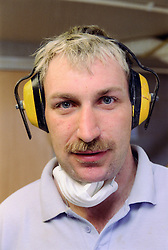 Portrait of man with learning disability wearing ear protectors,