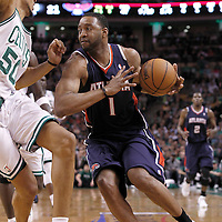10 May 2012: Atlanta Hawks small forward Tracy McGrady (1) drives past Boston Celtics Ryan Hollins during the Boston Celtics 83-80 victory over the Atlanta Hawks, in Game 6 of the Eastern Conference first-round playoff series, at the TD Banknorth Garden, Boston, Massachusetts, USA.