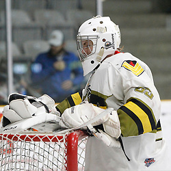 "TRENTON, ON  - MAY 3,  2017: Canadian Junior Hockey League, Central Canadian Jr. ""A"" Championship. The Dudley Hewitt Cup. Game 3 between Powassan Voodoos and the Dryden GM Ice Dogs.  Nate McDonald #33 of the Powassan Voodoos takes a break during the second period.<br /> (Photo by Tim Bates / OJHL Images)"