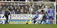 Photo: Dave Howarth.<br /> Wigan Athletic v Bolton Wanderers. Carling Cup.<br /> 20/12/2005.  Jason Roberts beats Bolton keeper Jussi Jasskelainen