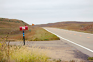 A Huskers decorated mailbox along Highway Two in Sandhills country near Seneca, Nebraska.