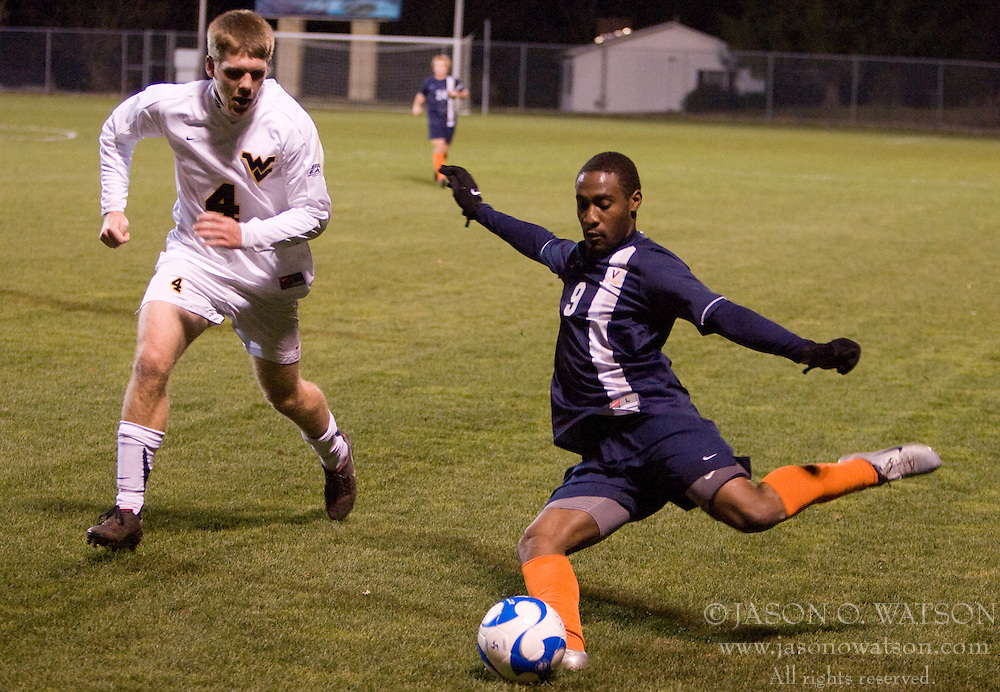 Virginia forward Matt Mitchell (9) crosses ahead of West Virginia defender Alex Erwin (4).  The West Virginia Mountaineers defeated the Virginia Cavaliers 1-0 in the second round of the 2007 NCAA Men's Soccer Tournament at Dick Dlesk Stadium in Morgantown, WV on November 28, 2007.