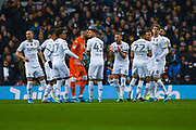 Leeds United players and Leeds United defender Liam Cooper (6) huddle during the EFL Sky Bet Championship match between Leeds United and Blackburn Rovers at Elland Road, Leeds, England on 9 November 2019.