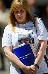 © Licensed to London News Pictures. 06/07/2016. London, UK. ELAINE FAIRLEY, sister of Senior Aircraftsman Peter McFerran wearing a t-shirt showing her brother an holding a copy of the Chilcot Report as she leaves the QE2 conference centre in London where the long-awaited Chilcot inquiry into the war in Iraq has been released. Photo credit: Ben Cawthra/LNP