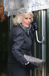 The Duchess of Cornwall uses an umbrella to shelter from the relentless rainfall as she arrives with the Prince of Wales for a visit to the BBC at New Broadcasting House in London, Tuesday, 11th February 2014. Picture by Stephen Lock / i-Images
