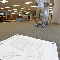 Thomas Wells | Buy at PHOTOS.DJOURNAL.COM<br /> Works use a diagram on the floor to make the right boxes get dropped in the correct area before assbly can start at the new Tupelo Police Headquarters on Front Street.
