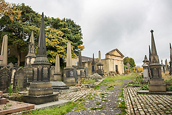 © Licensed to London News Pictures. 21/10/2015. Halifax, UK. The Victorian Grade 2 listed Lister Lane Cemetery in Halifax that dates back to 1841 has been recognised as a Significant Cemetery in Europe, one of only 13 in the UK putting it alongside such famous cemeteries as Highgate in London. The cemetery houses burial plots of James Uriah Walker who was the owner of the Halifax Guardian & the first person to publish the Bronte sister's work, The Crossley family who's mill became the largest carpet manufacturing business in the world & numerous veterans of the battle of Waterloo. Photo credit: Andrew McCaren/LNP