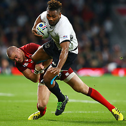LONDON, ENGLAND - SEPTEMBER 18: Mike Brown of England tackling Metuisela Talebula of Fiji during the Rugby World Cup 2015 Pool A match between England and Fiji at Twickenham Stadium on September 18, 2015 in London, England. (Photo by Steve Haag Emirates)