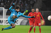 Thu., Feb. 14, 2013, Russia, St. Petersburg. .Zenit St. Petersburg's Netu, left, against Liverpool's Raheem Sterling, center, in the UEFA Europa League's last 32 match..Kommersant Photo/Alexander Petrosyan