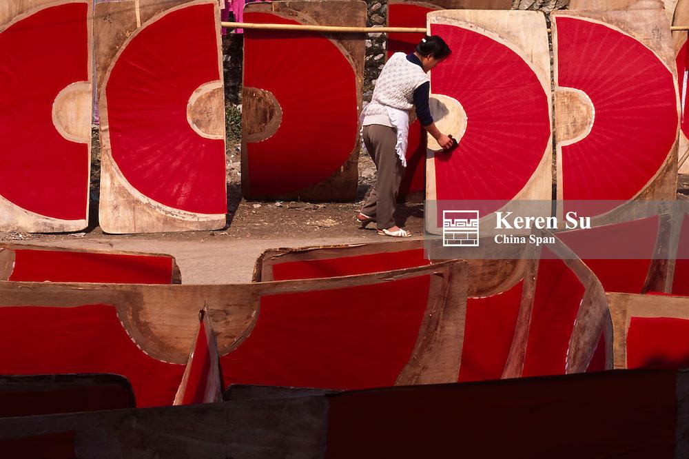 Making red fans, Yangshuo, Guangxi Province, China
