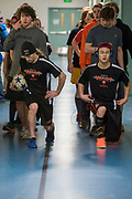Dawson Ellingworth, left, and James<br /> Batman, right, lead the team in pre game warm-ups before the 2015 State Hockey Championships at the Curtis D. Menard Memorial Sports Center Saturday night. WHS won 4-3.