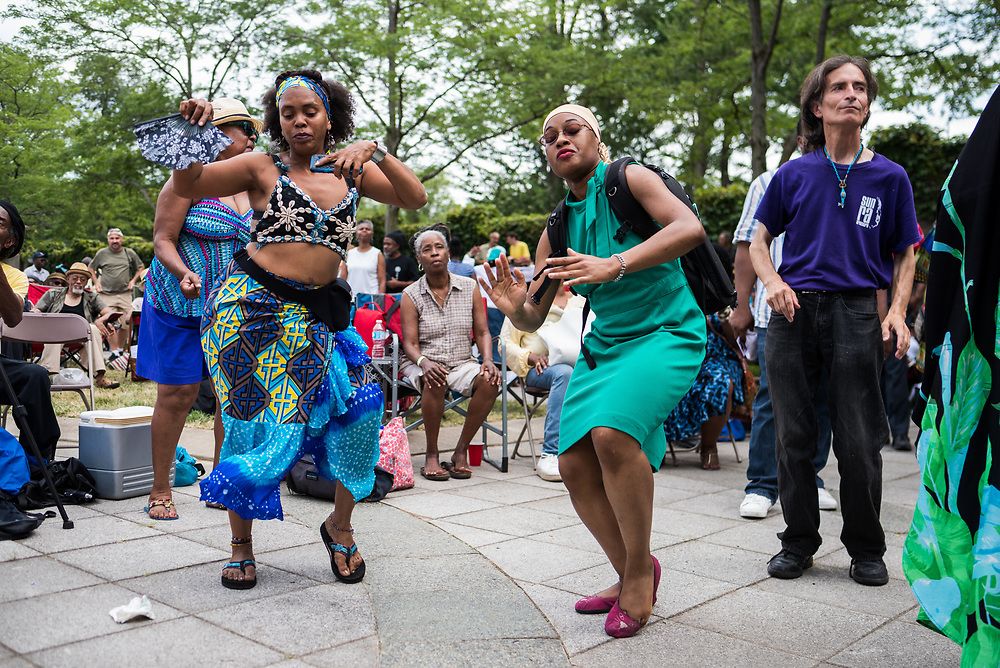 Africa Pace Brown, daughter of late singer Oscar Brown Jr., and Shanel Taylor dance to the sounds of AACM Great Black Music Ensemble at 63rd Street Beach during the 50th Anniversary of Kelan Phil Cohran's performance series, On the Beach, on July 9, 2017. Phil Cohran passed away just a week before the revival of the On The Beach series.