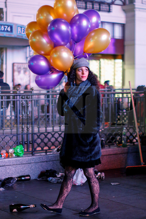 © Licensed to London News Pictures. 01/01/2017. London, UK. Revellers celebrate the New Year in central London during the first hours of 2017 on January 1. Photo credit: Tolga Akmen/LNP