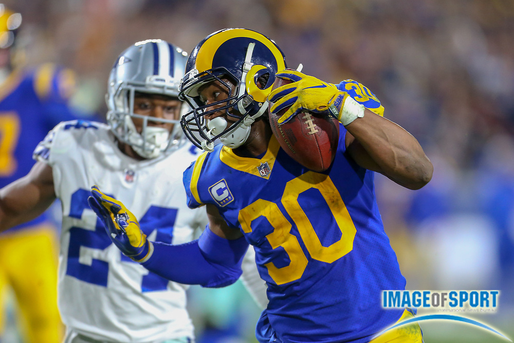 Jan 12, 2019; Los Angeles, CA, USA; Los Angeles running back Todd Gurley (30) runs for a touchdown in the second quarter against the Dallas Cowboys during an NFL divisional playoff game at the Los Angeles Coliseum. The Rams beat the Cowboys 30-22. (Kim Hukari/Image of Sport)