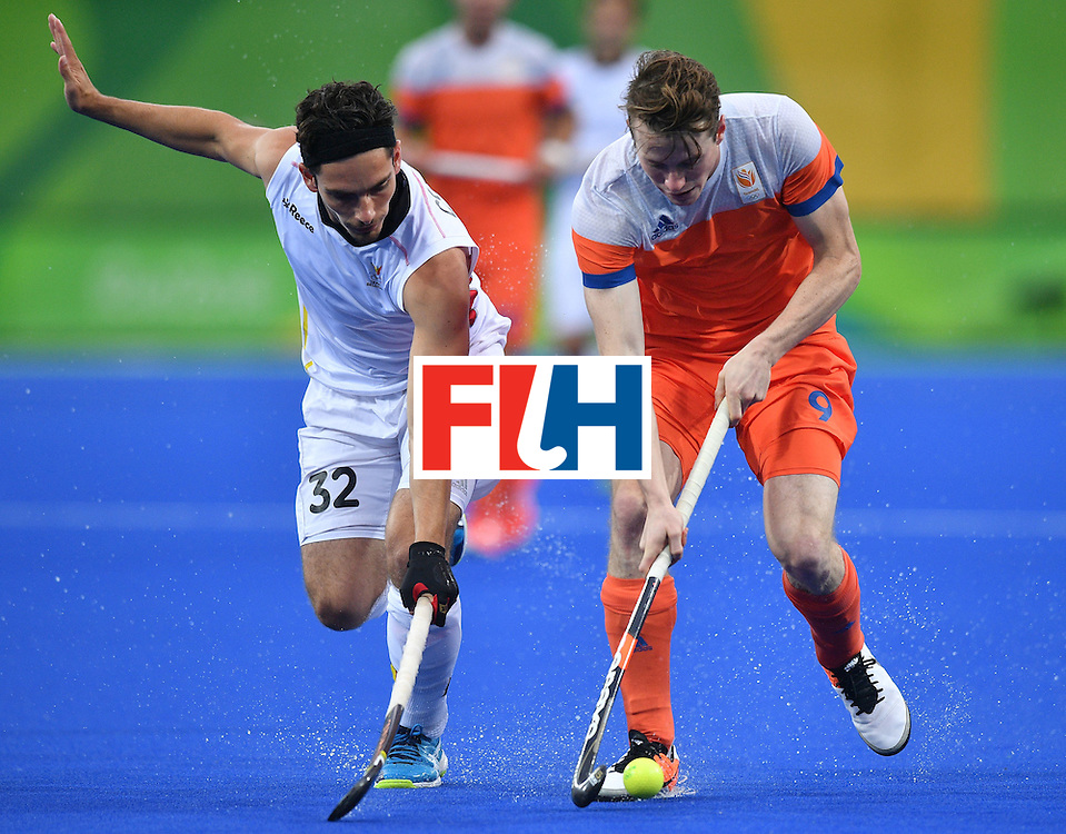Netherland's Seve van Ass (R) vies with Belgium's Tanguy Cosyns during the men's semifinal field hockey Belgium vs Netherlands match of the Rio 2016 Olympics Games at the Olympic Hockey Centre in Rio de Janeiro on August 16, 2016. / AFP / Carl DE SOUZA        (Photo credit should read CARL DE SOUZA/AFP/Getty Images)
