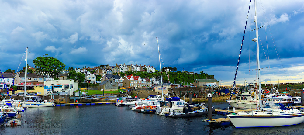 View overlooking Ballycastle Harbour with some brilliantly dramatic clouds in the background