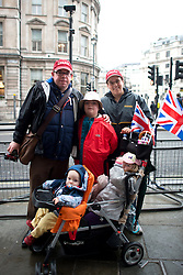 © Licensed to London News Pictures. 17/04/2013. London, UK. Family from Canada waits for the funeral of former British Prime Minister Baroness Thatcher at Trafalgar square on April 17, 2013 in London, England. Photo credit : Peter Kollanyi/LNP