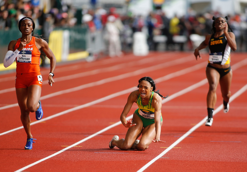 Florida's Kyra Jefferson, left, heads toward the finish line as Oregon's Deajah Stevens, center, falls infront of Iowa's Brittany Brown during the women's 200 meters in the time of 22.02 seconds on the final day of the NCAA outdoor college track and field championships in Eugene, Ore., Saturday, June 10, 2017. (AP Photo/Timothy J. Gonzalez)