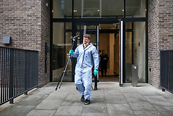 © Licensed to London News Pictures. 23/11/2019. London, UK. Forensic officer outside Blakeney Tower on Buckle Street in Tower Hamlets, East London following a fatal stabbing.<br /> Police were called to a residential address in Blakeney Tower on Buckle Street, Tower Hamlets in East London at 08.48hrs this morning following reports of a stabbing. A male, in his 20s, was found with stab injuries. Despite the efforts of emergency services, he was pronounced dead at the scene. Three other males with stab injuries were treated at the scene by paramedics before being taken to hospital. Photo credit: Dinendra Haria/LNP