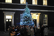 © Licensed to London News Pictures. 12/12/2011, London, UK.Marylebone  Community Choir on Downing Street today, Monday 12th December 2011. Photo credit : Stephen Simpson/LNP
