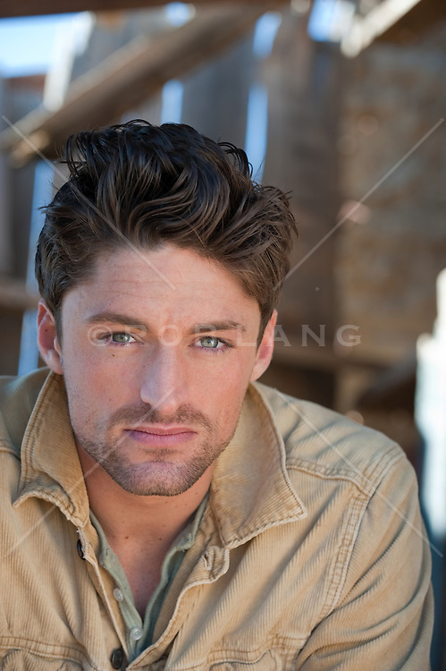 Portrait of a brown hair blue eye man