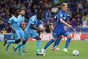 AFC Wimbledon striker Joe Pigott (39) dribbling away from Coventry City players during the EFL Sky Bet League 1 match between AFC Wimbledon and Coventry City at the Cherry Red Records Stadium, Kingston, England on 11 August 2018.